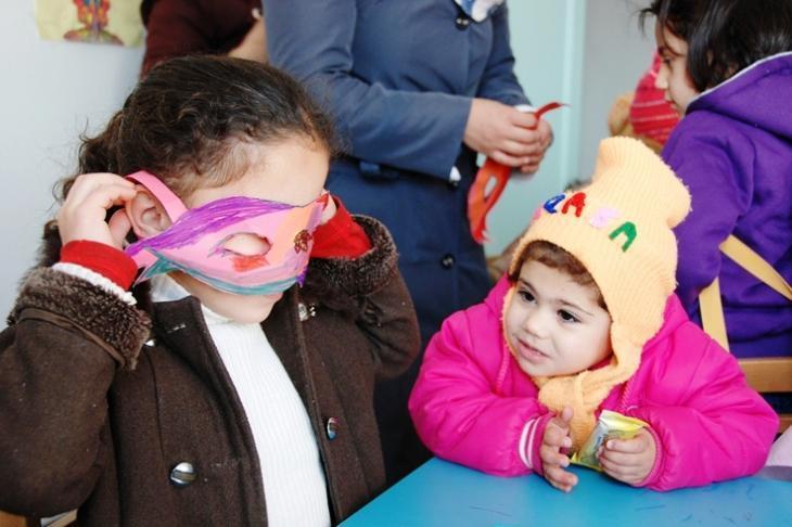 Children making paper masks in a kindergarten in Manshia, Jordan (photo: Laura Overmeyer)