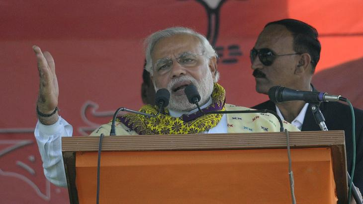 BJP Prime Ministerial candidate Narendra Modi delivering his speech at Gogamukh in the Dhemaji district in Assam on 31 March 2014 (photo: UNI)