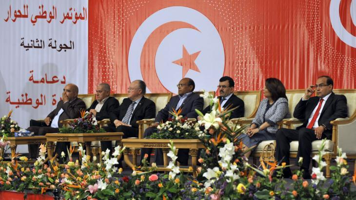 Tunisian President Moncef Marzouki (centre) during a National Dialogue meeting in Tunis on 16 May 2013 (photo: FETHI BELAID/AFP/Getty Images)