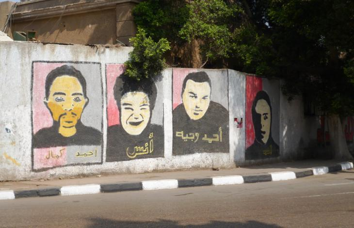 Images of martyrs painted on a wall in central Cairo (photo: Arian Fariborz)