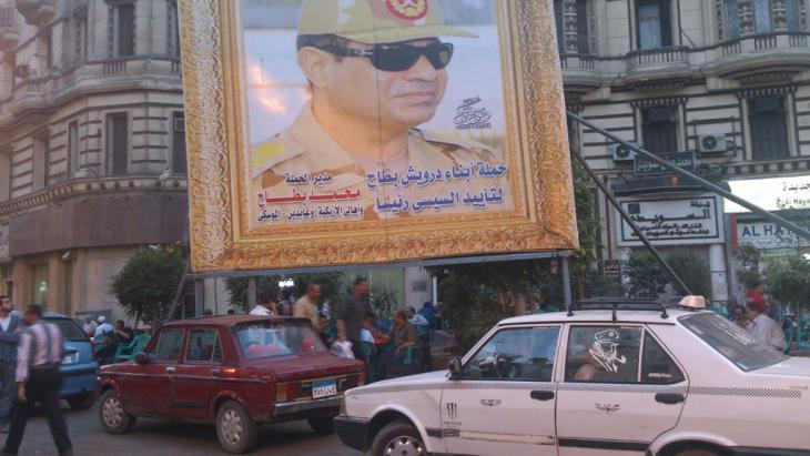 Poster of Abdul Fattah al-Sisi in a golden frame in Cairo (photo: Ahmed Wael)
