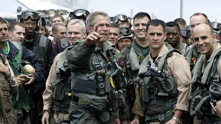 US President George W. Bush meets pilots and crew members of the aircraft carrier USS Lincoln on 1 May 2003 (HECTOR MATA/AFP/Getty Images)