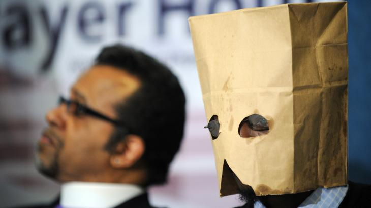 A gay Ugandan man seeking asylum in the US hides his face with a hood at a press conference in Washington DC, February 2010 (photo: Jewel Samad/AFP/Getty Images)