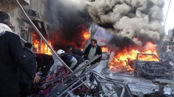 The aftermath of the Syrian Air Force's bombardment of the city of Aleppo with barrel bombs (photo: Getty Images)