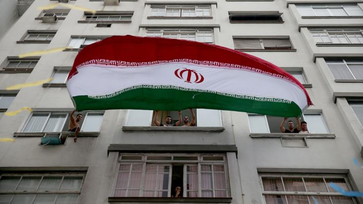 Iranian soccer fans wave a huge Iranian flag from their windows as the World Cup tournament enters its second day on 13 June 2014 in Rio de Janeiro, Brazil (photo: Joe Raedle/Getty Images)