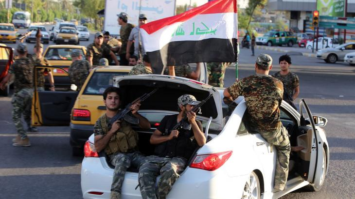 Iraqi Shia tribesmen driving around Baghdad (photo: AFP/Getty Images)