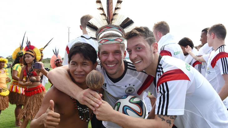 The German national team receives a visit from locals in traditional costumes during training in Campo Bahia, Brazil. Photo: Getty Images