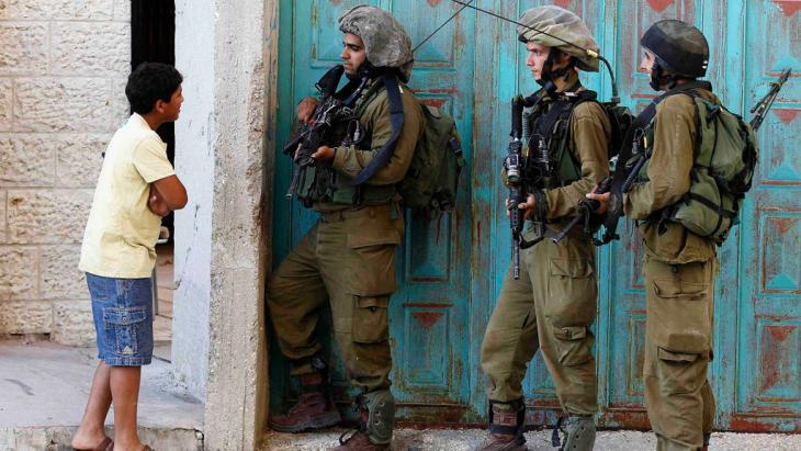 Israeli soldiers during a raid in Hebron (photo: Reuters/Ammar Awad)