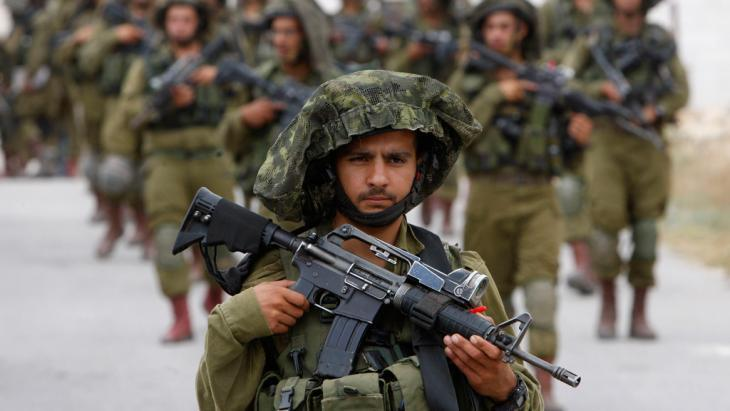 Israeli soldiers in the West Bank (photo: Reuters/Mussa Qawasma)