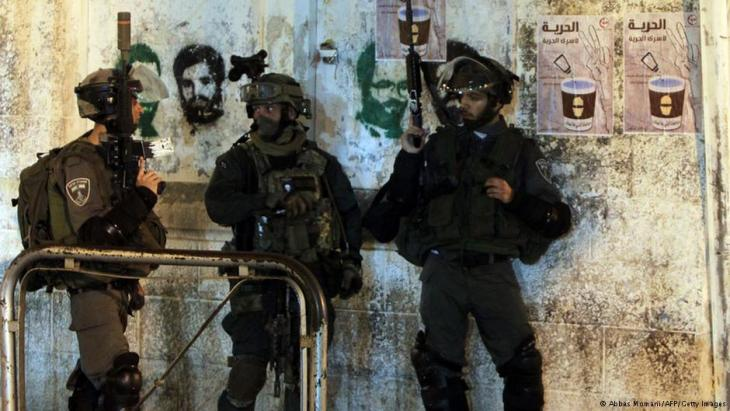 Israeli soldiers raiding a house in the West Bank, June 2014. Photo: AFP/Getty Images