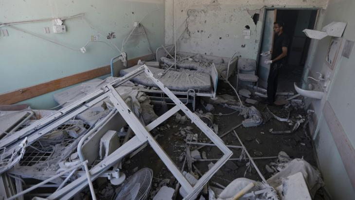 Damage sustained by al-Aqsa Martyrs hospital in Deir al-Balah, Gaza, on 21 July 2014 (photo: MOHAMMED ABED/AFP/Getty Images)
