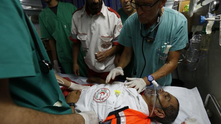 Man receiving treatment at al-Shifa Hospital, in Gaza City, 18 July 2014 (photo: MOHAMMED ABED/AFP/Getty Images)