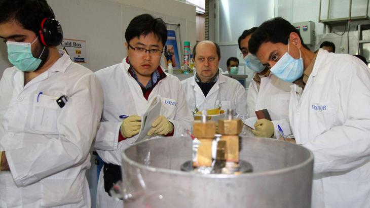 Inspectors from the International Atomic Energy Agency (IAEA) and Iranian engineers in the Natanz facility, Iran, on 20 January 2014 (photo: AFP/Getty Images)