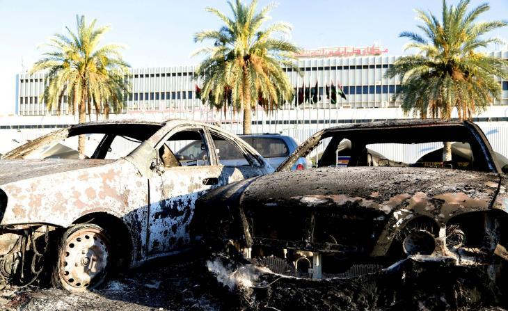 Burned-out cars outside Tripoli International Airport (photo: Osama Alfitory)