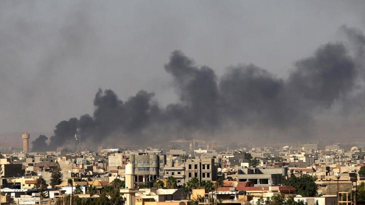 Dark smoke rising above the Tripoli skyline (photo: Reuters)