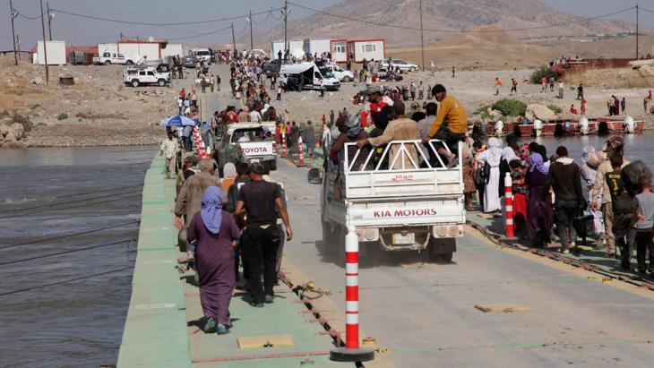 Yazidis who fled into Syria following violence in Sinjar, re-entering Iraq (photo: Reuters)