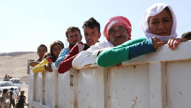 Iraqi Yazidis fleeing Sinjar arrive in Fishkhabour, Dohuk province, Iraq (photo: Reuters)