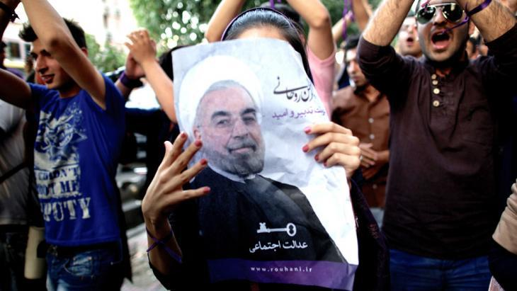 A supporter of President Hassan Rouhani in Tehran (photo. Behrouz Mehri/AFP/Getty Images)