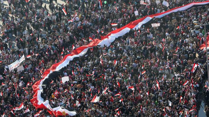 Egyptians celebrate the day marking one week after Egypt's president Hosni Mubarak was forced to step down by nation-wide mass protests in 2011 (photo: Mohammed Abed/AFP/Getty Images)