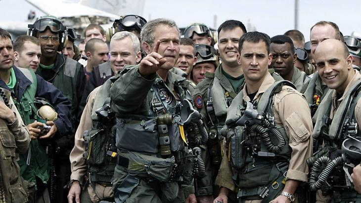 US President George W. Bush meeting pilots and crew members of the aircraft carrier USS Lincoln on 1 May 2003 (HECTOR MATA/AFP/Getty Images)