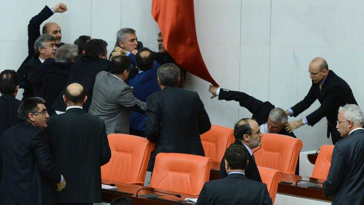 Members of the Turkish parliament from the AKP and CHP fighting in the parliament in Ankara (photo: AFP/Getty Images)