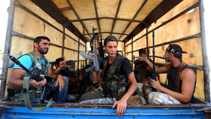 FSA fighters in the Salaheddin quarter of Aleppo (photo: picture-alliance/abaca)