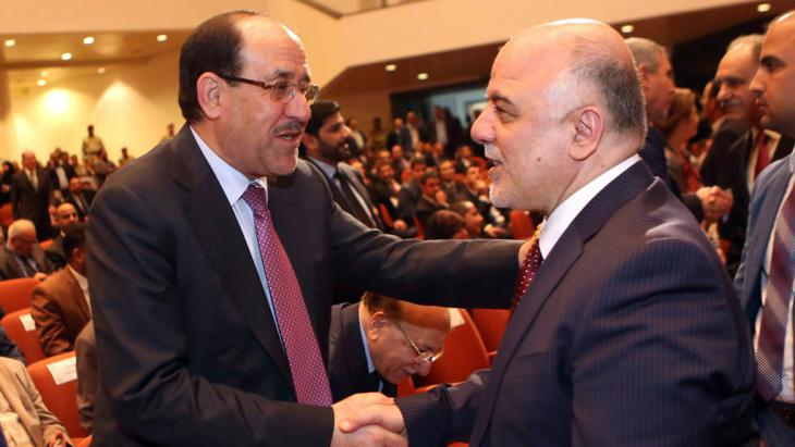 Nouri al-Maliki (left) congratulates Haider al-Abadi (photo: Reuters/Hadi Mizban)