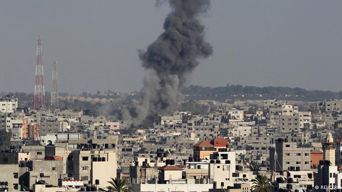 Gaza city under a cloud of smoke (photo: Reuters)