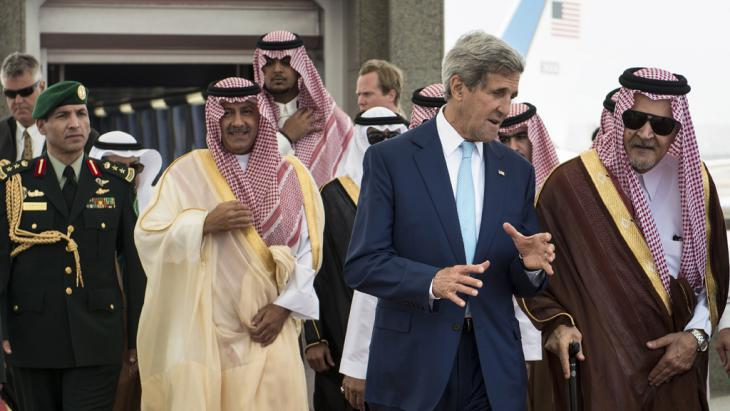 US Secretary of State John Kerry (second right) speaking to the Saudi Foreign Minister HRH Saud al-Faisal (photo: AFP/Getty Images/Brendan Smialowski)