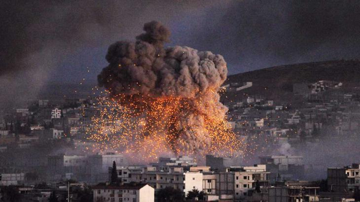 An explosion in the city of Kobani after an IS suicide bomb attack on 20 October 2014 (photo: Reuters)