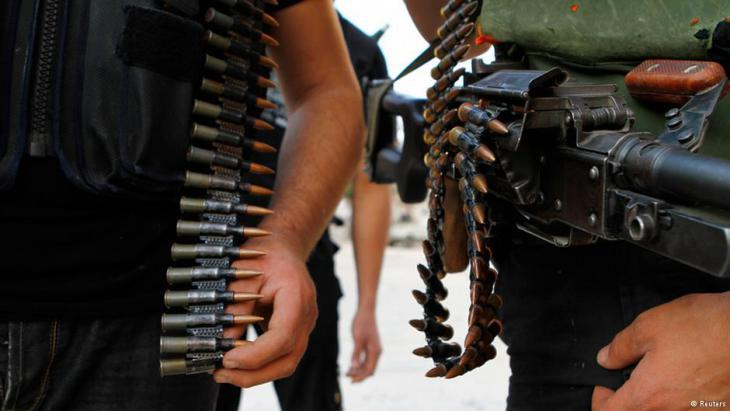 Syrian rebels with guns and ammunition (photo: Reuters)