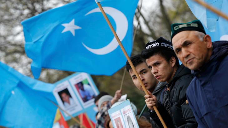 Uighurs protesting against China's president Xi Jinping in Berlin (photo: Reuters)