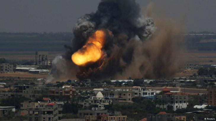 A rocket lands in Gaza city (photo: Reuters)