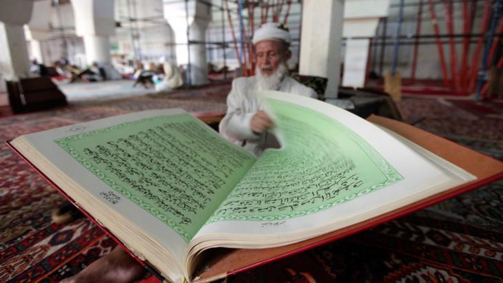 A Yemeni man studying the Koran in Sanaa (photo: Reuters)