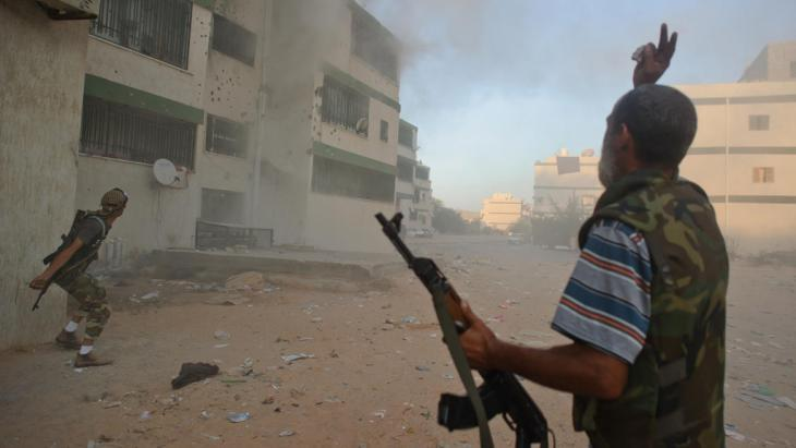 Libyan rebels in Abou Selim (photo: picture-alliance/dpa/C. Petit Tesson)