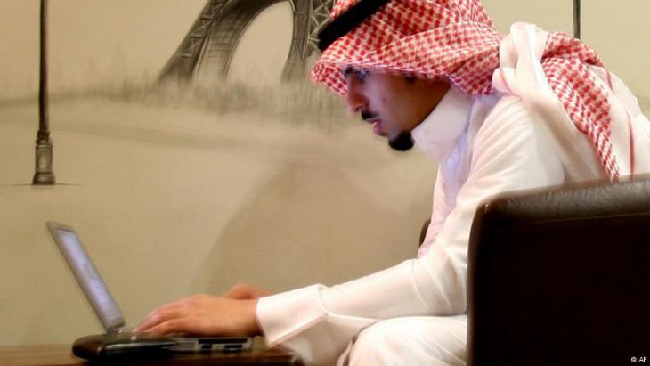 A young Saudi man in an Internet cafe in Riyadh (photo: AP)