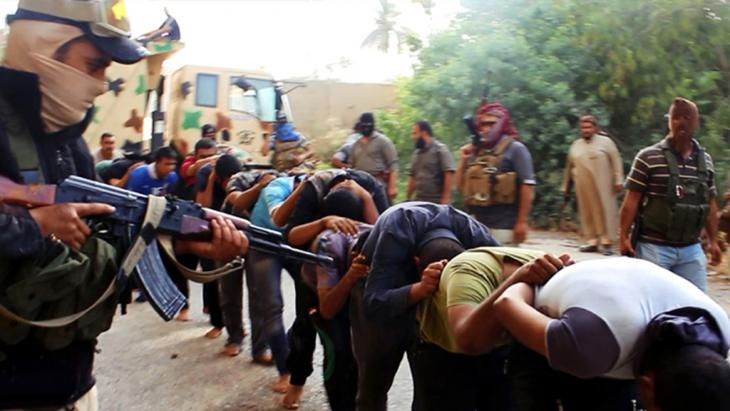 IS militants leading away captured Iraqi soldiers, Tikrit, Iraq, 14 June 2014 (photo: AP)