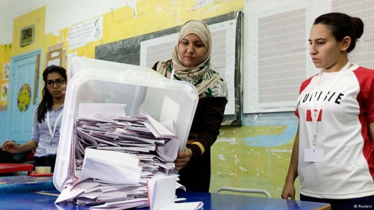 Women preparing to count votes in Tunis after the recent election (photo: Reuters)