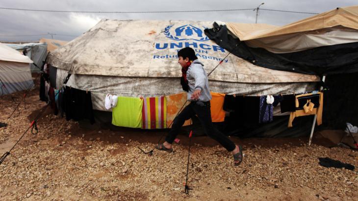 A child running through the Zaaatari refugee camp in Jordan (photo: AP)