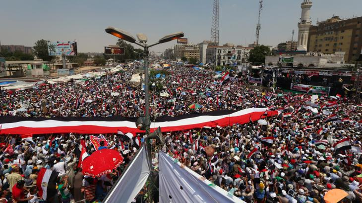 Pro-Morsi supporters during their week-long sit-in at a crossroads in front of the Rabaa al-Adawiya Mosque in Cairo (photo: Marwan Naamani/AFP/Getty Images)