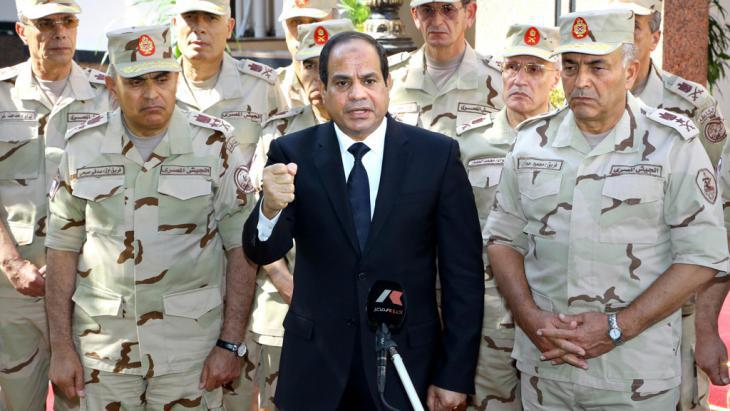 Abdul Fattah al-Sisi surrounded by senior members of the military (photo: Reuters/The Egyptian presidency)