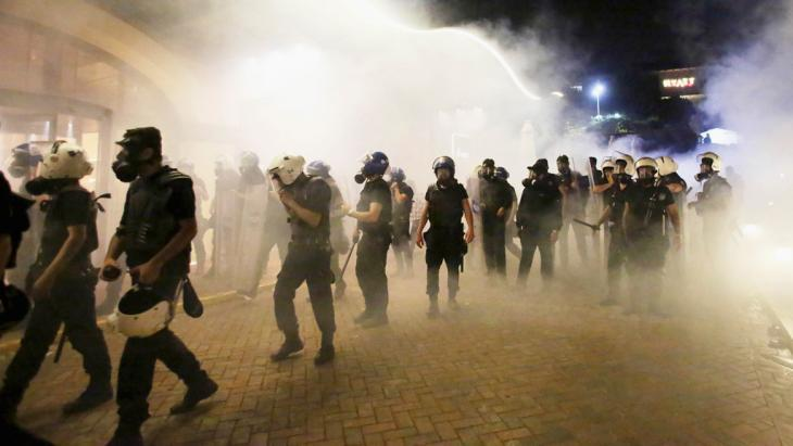 Turkish riot police in clouds of tear gas in Istanbul during the move to clear Gezi Park on 15 June 2013 (photo: Reuters)