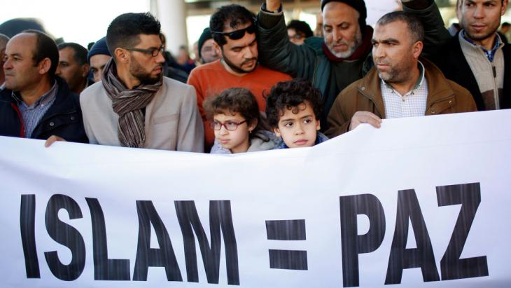 "Members of the Muslim community walk behind a banner that reads, ""Islam = Peace"" during a rally in Madrid, 11 January 2015 (photo: REUTERS/J. Medina)"