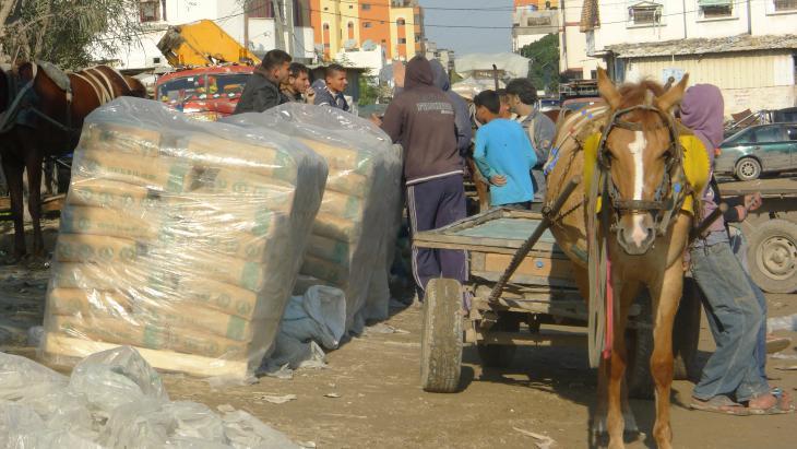 Cement traders outside the Shamali warehouse in Shejaia, Gaza (photo: Ylenia Gostoli)