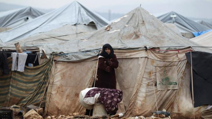 A Syrian refugee in Al-Karameh near the Syrian-Turkish border (photo: Reuters/K. Ashawi)