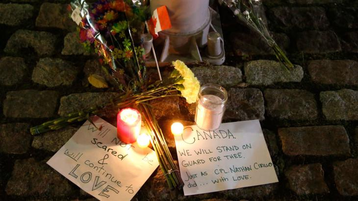 Flowers and candles left by mourners at the National War Memorial in Ottawa, Canada, after a soldier was killed by Michael Zehaf-Bibeau, a Canadian citizen and convert to Islam, on Wednesday, 22 October 2014 (photo: AP Photo/The Canadian Press, Patrick Doyle)
