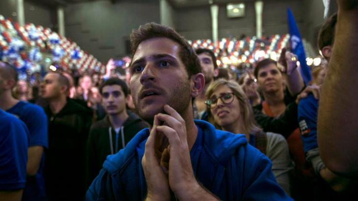 A Zionist Union party supporter reacts to exit poll results, Tel Aviv, 17 March 2015 (photo: Reuters/B. Ratner)