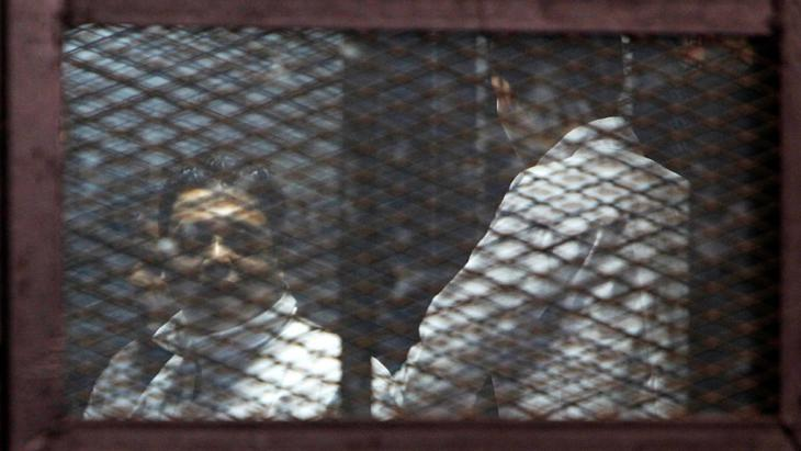 Detained members of the Muslim Brotherhood during a trial in Cairo (photo: Reuters/M. Abd El Ghany)