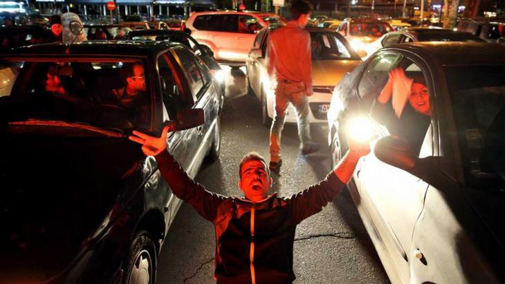 People celebrate on the streets of Tehran following news of the Lausanne agreement (photo: Reuters)