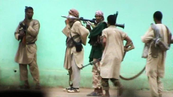 "Still from a video released by ""al-Qaida in the Islamic Maghreb"" showing militants on the streets of Gao, Mali, June 2012 (photo: AFP/Getty Images)"